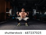 man at the gym executing... | Shutterstock . vector #687237025