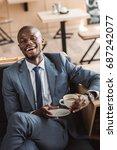 handsome african american... | Shutterstock . vector #687242077