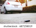 lost fall car key on the street ... | Shutterstock . vector #687258019