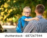 parent taking child to school.... | Shutterstock . vector #687267544