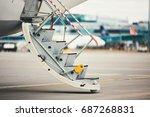 airplane with open door is... | Shutterstock . vector #687268831
