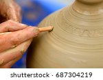 hands of a potter. potter... | Shutterstock . vector #687304219