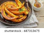 baked slices of pumpkin with...   Shutterstock . vector #687313675