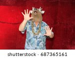 a man poses for photos in a...   Shutterstock . vector #687365161