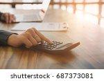 young businesswoman working... | Shutterstock . vector #687373081