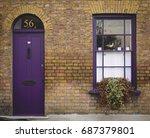 Purple Door And Window Of A...