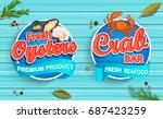 seafood emblems on blue wooden... | Shutterstock .eps vector #687423259