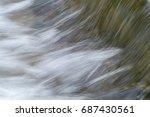 water flowing over a weir ... | Shutterstock . vector #687430561