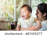 little baby is showing a happy... | Shutterstock . vector #687435277