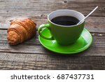 coffee in a green mug on wooden ... | Shutterstock . vector #687437731