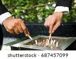 close up hand businessman two... | Shutterstock . vector #687457099