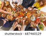 friends dinner table top view.... | Shutterstock . vector #687460129