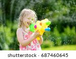 adorable little girl playing... | Shutterstock . vector #687460645