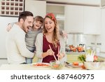 happy family in the kitchen... | Shutterstock . vector #687460975