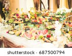 various sweet sliced fruit on a ... | Shutterstock . vector #687500794
