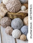 basket with balls of yarn on a... | Shutterstock . vector #687509821