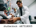 pharmacist looking for a drug... | Shutterstock . vector #687518005