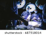 group of surgeons in operating... | Shutterstock . vector #687518014