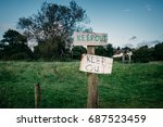 Small photo of Keep out signs barring entry on a fence on a farm field in Devon England.