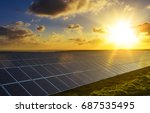 solar panels at sunrise with... | Shutterstock . vector #687535495
