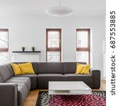 Small photo of Comfortable corner couch in modern apartment living room