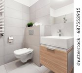 Small photo of Bathroom with toilet, mirror and modern basin cabinet