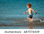 a little boy with blonde curly...   Shutterstock . vector #687576439