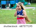 a little girl is wearing an...   Shutterstock . vector #687577195