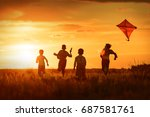 children launch a kite in the... | Shutterstock . vector #687581761