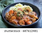 osso bucco beef stew with... | Shutterstock . vector #687612481