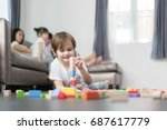 asian boy playing wood toy in... | Shutterstock . vector #687617779