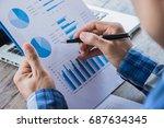 businessman analyzing financial ... | Shutterstock . vector #687634345