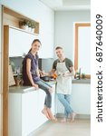 couple cooking together in... | Shutterstock . vector #687640009