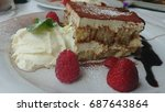 tiramisu with cherry and sauce | Shutterstock . vector #687643864