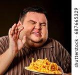 diet failure of fat man eating...   Shutterstock . vector #687665329