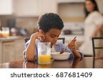 cute little boy eating... | Shutterstock . vector #687681409