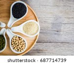white sesame in a wooden spoon... | Shutterstock . vector #687714739