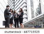happy business team in city... | Shutterstock . vector #687715525