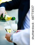 two men pouring champagne... | Shutterstock . vector #68773537