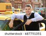Handsome Taxi Driver Standing...