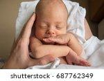 baby on mother's hands | Shutterstock . vector #687762349