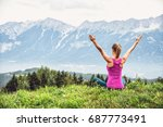 young woman meditate on top of... | Shutterstock . vector #687773491