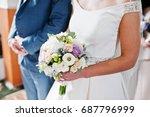 bride holding a wedding bouquet ... | Shutterstock . vector #687796999