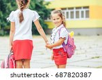 two cute girls go to school... | Shutterstock . vector #687820387