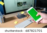 he touch the smart phone use... | Shutterstock . vector #687821701