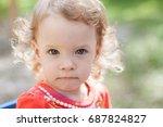little curly girl on a walk on... | Shutterstock . vector #687824827