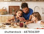little sisters cooking with her ... | Shutterstock . vector #687836389