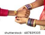 indian young sister tying rakhi ... | Shutterstock . vector #687839335