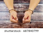 close up of handcuffed man on... | Shutterstock . vector #687840799