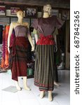 Small photo of Thailand-July 2017 : Thai Ikat woven costumes for sale on ancient pattern weaving center in Ban Mi district of Lopburi,Thailand.Traditional handicraft fabrics are popular for dressing and collecting.